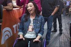 """Former Olympic swimmer Amy Van Dyken-Rouen poses for a photo as she sits in her wheelchair and listens to Usher perform on NBC's """"Today Show"""" in the Manhattan borough of New York September 5, 2014. REUTERS/Carlo Allegri"""