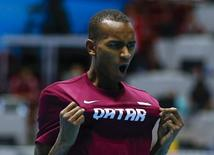 First placed Mutaz Essa Barshim of Qatar celebrates after the men's high jump final at the world indoor athletics championships at the ERGO Arena in Sopot March 9, 2014.                 REUTERS/Kai Pfaffenbach