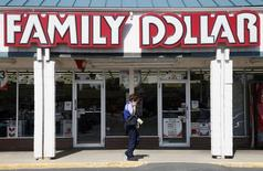 A woman walks by the Family Dollar store in Arvada, Colorado October 7, 2009.  REUTERS/Rick Wilking