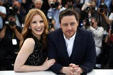 """Cast members Jessica Chastain (L) and James McAvoy pose during a photocall for the film """"The Disappearance of Eleanor Rigby"""" in competition for the category """"Un Certain Regard"""" at the 67th Cannes Film Festival in Cannes May 18, 2014.      REUTERS/Eric Gaillard"""