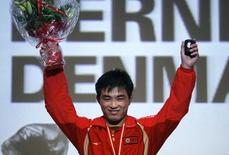 North Korea's Yang Kyong-il celebrates on the podium after winning the gold medal in the men's 55 kg free-style at the World Wrestling Championships 2009 in Herning September 21, 2009. REUTERS/Bob Strong