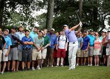 Sep 14, 2014; Atlanta, GA, USA; Rory McIlroy hits his third shot in the rough on the ninth hole during the final round of the Tour Championship at East Lake Golf Club. Mandatory Credit: Jason Getz-USA TODAY Sports