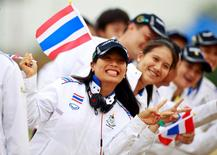 Thai princess Sirivannavari Nariratana (L) poses with the Thai Equestrian team during the opening ceremony of the Equestrian competition at  27th SEA Games in Naypyitaw December 10, 2013. REUTERS/Soe Zeya Tun/Files