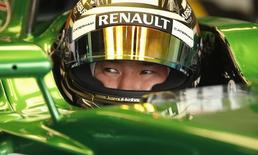 Caterham Formula One driver Kamui Kobayashi of Japan sits in his car during second practice ahead of the British Grand Prix at the Silverstone Race Circuit, central England, July 4, 2014. REUTERS/Phil Noble