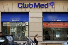 A woman walks past a Club Med travel agency in Paris, July 24, 2014. REUTERS/Benoit Tessier