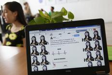 A cartoon is seen in this photograph of the Twitter web page of cartoonist Rayma Suprani, in Caracas September 18, 2014.  REUTERS/Carlos Garcia Rawlins