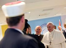 """Pope Francis arrives for a meeting with representatives of Albania's Muslim, Orthodox and Catholic communities, at the Catholic University """"Our Lady of Good Counsel"""" in Tirana, September 21, 2014. REUTERS/Alessandra Tarantino/Pool"""