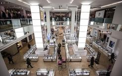 People shop inside at the Hudson's Bay Company (HBC) flagship department store in Toronto January 27, 2014. REUTERS/Mark Blinch
