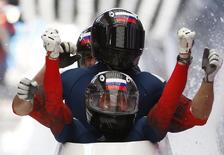 Russia's pilot Alexander Zubkov and and his team mates celebrate finishing first during the four-man bobsleigh event of the Sochi 2014 Winter Olympic Games at the Sanki Sliding Center in Rosa Khutor February 23, 2014.  REUTERS/Murad Sezer