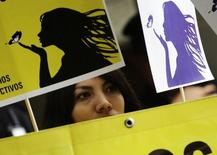 A member of Amnesty International attends a demonstration outside the El Salvador embassy in Mexico City, May 29, 2013, in support of a 22-year-old Salvadoran woman identified as Beatriz, who is seeking an abortion.  REUTERS/Henry Romero