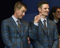 Team Europe players Henrik Stenson (L) and Justin Rose react after being announced as the first pairing for Europe during the opening ceremony of the 40th Ryder Cup, at Gleneagles in Scotland September 25, 2014. REUTERS/Toby Melville