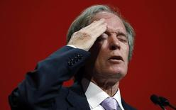 Bill Gross, co-founder and co-chief investment officer of Pacific Investment Management Company (PIMCO), gestures as he speaks at the Morningstar Investment Conference in Chicago, Illinois, June 19, 2014.  REUTERS/Jim Young