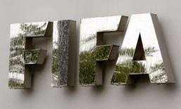 Water flows over the FIFA logo in front of the FIFA headquarters during heavy rainfall in Zurich July 22, 2011. REUTERS/Arnd Wiegmann/Files