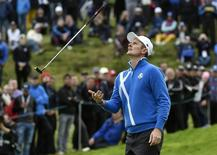 European Ryder Cup player Justin Rose filps his putter after missing his putt on the 13th green during his foursomes 40th Ryder Cup match at Gleneagles in Scotland September 26, 2014.    REUTERS/Toby Melville