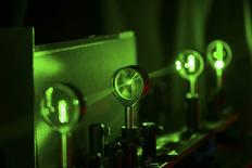 A cloaking device using four lenses developed by University of Rochester physics professor John Howell and graduate student Joseph Choi is demonstrated in Rochester, New York in this September 11, 2014 University of Rochester.REUTERS/J. Adam Fenster/University of Rochester/Handout via Reuters