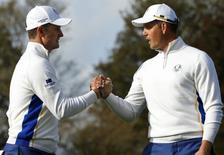 European Ryder Cup player Justin Rose (L) and  Henrik Stenson celebrate on the 11th green during their fourballs 40th Ryder Cup match at Gleneagles in Scotland September 27, 2014.     REUTERS/Russell Cheyne