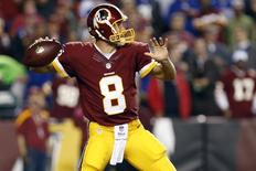 Sep 25, 2014; Landover, MD, USA; Washington Redskins quarterback Kirk Cousins (8) throws the ball against the New York Giants in the first quarter at FedEx Field. Mandatory Credit: Geoff Burke-USA TODAY Sports