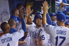Sep 30, 2014; Kansas City, MO, USA; Kansas City Royals first baseman Eric Hosmer (35) celebrates with teammates after scoring against the Oakland Athletics during the eighth inning of the 2014 American League Wild Card playoff baseball game at Kauffman Stadium.  Denny Medley-USA TODAY Sports