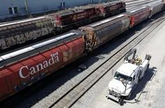 Canadian Pacific Railway crews drive past trains at the CP Rail yards in Calgary, Alberta, April 29, 2014. REUTERS/Todd Korol