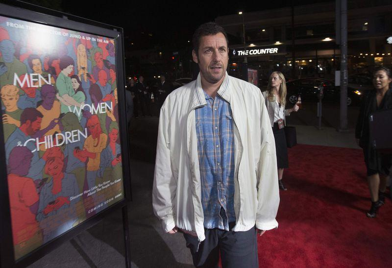 Comedy actor Adam Sandler signs four-film deal with Netflix - Reuters