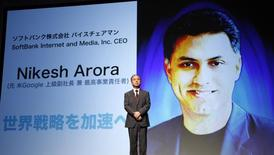 SoftBank Corp. Chief Executive Masayoshi Son attends a news conference as screen shows pictures of Nikesh Arora, former Google chief business officer and currently SoftBank Internet and Media, Inc.'s CEO in Tokyo August 8, 2014. REUTERS/Yuya Shino