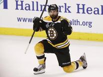 Boston Bruins' Johnny Boychuk celebrates his goal against the Chicago Blackhawks during the third period in Game 4 of their NHL Stanley Cup Finals hockey series in Boston, Massachusetts, June 19, 2013. REUTERS/Winslow Townson