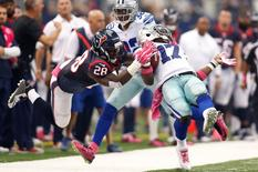 Oct 5, 2014; Arlington, TX, USA; Dallas Cowboys wide receiver Dwayne Harris (17) is tackled by Houston Texans running back Alfred Blue (28) on a punt return in the fourth quarter at AT&T Stadium. Dallas beat Houston 20-17 in overtime. Mandatory Credit: Tim Heitman-USA TODAY Sports