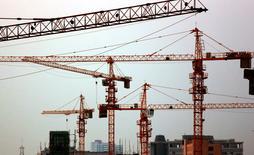 A Jiujiang, dans la province chinoise de Jiangxi. La Banque mondiale a réduit ses prévisions de croissance de 2014 à 2016 pour l'est de l'Asie, faisant état entre autres d'un probablement ralentissement de la croissance en Chine et signalant un risque de fuite des capitaux en Indonésie. La croissance pour la région serait de 6,9% en 2014 et 2015, contre des anticipations de 7,1% auparavant. /Photo prise le 30 juillet 2014/REUTERS