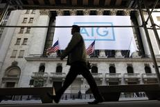 A banner for American International Group Inc (AIG) hangs on the facade of the New York Stock Exchange, in this file photo taken Ocotber 16, 2012.  REUTERS/Brendan McDermid/Files
