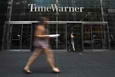 A woman walks past the Time Warner Center near Columbus Circle in Manhattan, New York in this July 16, 2014 file photo. REUTERS/Adrees Latif/Files