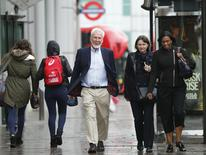 Professor John O'Keefe (C) walks along Euston Road on his way to a news conference in London October 6, 2014. REUTERS/Suzanne Plunkett
