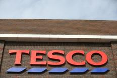 A sign spells out the store name on a Tesco store in Bow, east London August 29, 2014. REUTERS/Paul Hackett