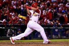 Oct 6, 2014; St. Louis, MO, USA; St. Louis Cardinals second baseman Kolten Wong (16) hits a two run home run during the seventh inning against the Los Angeles Dodgers in game three of the 2014 NLDS baseball playoff game at Busch Stadium. Mandatory Credit: Scott Rovak-USA TODAY Sports