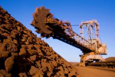 A stack reclaimer with a pile of iron ore at the Rio Tinto Parker Point ship loading terminal in the Pilbara region of West Australia is seen in this undated handout photo.   REUTERS/Rio Tinto