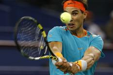 Rafael Nadal of Spain returns a shot during his men's singles tennis match against Feliciano Lopez of Spain at the Shanghai Masters tennis tournament in Shanghai October 8, 2014. REUTERS/Aly Song