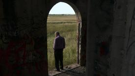 """Jay Reinke is shown in this film production still photo framed by the doorway of an abandoned church, in the film """"The Overnighters"""" in this undated handout photo in Williston, North Dakota, provided by Drafthouse Films October 7, 2014. REUTERS/Drafthouse Films"""