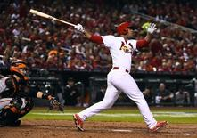 Oct 12, 2014; St. Louis, MO, USA; St. Louis Cardinals pinch hitter Oscar Taveras (18) hits a solo home run against the San Francisco Giants during the 7th inning in game two of the 2014 NLCS playoff baseball game at Busch Stadium. Jasen Vinlove-USA TODAY Sports