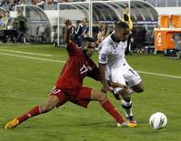 Joe Gyau (R) of the U.S. battles for the ball with Dayron Blanco of Cuba during their CONCACAF Olympic qualifying soccer match in Nashville, Tennessee, March 22, 2012. REUTERS/Harrison McClary
