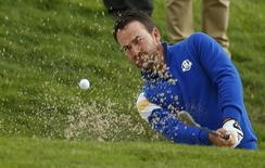 European Ryder Cup player Graeme McDowell hits out of a bunker on the third hole during the 40th Ryder Cup singles matches at Gleneagles in Scotland September 28, 2014.  REUTERS/Russell Cheyne