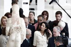 Human rights lawyer Amal Alamuddin Clooney observes a Kore statue during a visit at the Acropolis museum in Athens October 15, 2014.   REUTERS/Yorgos Karahalis