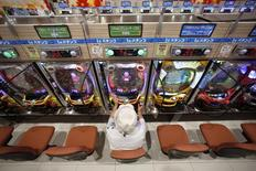 A visitor plays pachinko at Dynam's pachinko parlour in Fuefuki, west of Tokyo June 19, 2014. REUTERS/Issei Kato