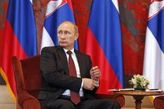 Russian President Vladimir Putin looks on during a meeting with Serbian President Tomislav Nikolic (not pictured) at Serbia Palace building in Belgrade October 16, 2014. Putin is guest of honor at a military parade on Thursday to mark 70 years since the city's liberation by the Red Army, a visit loaded with symbolism as Serbia walks a tightrope between the Europe it wants to join and a big-power ally it cannot leave behind.   REUTERS/Marko Djurica (SERBIA  - Tags: POLITICS)