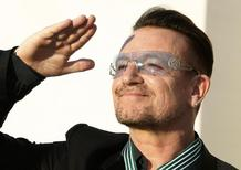 Bono, lead singer of the band U2, reacts after being awarded Commandeur des Arts et lettres (Commander in the Order of Arts and Letters) during a ceremony in Paris, in this file photo taken July 16, 2013.   REUTERS/Charles Platiau/Files