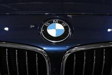 A BMW logo is seen on a car displayed on media day at the Paris Mondial de l'Automobile, October 3, 2014. REUTERS/Benoit Tessier