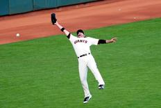 Oct 16, 2014; San Francisco, CA, USA; San Francisco Giants left fielder Travis Ishikawa (45) cannot get to an RBI double by St. Louis Cardinals center fielder Jon Jay (not pictured) during the third inning of game five of the 2014 NLCS playoff at AT&T Park. Mandatory Credit: Ed Szczepanski-USA TODAY Sports