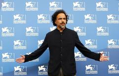 Director Alejandro Inarritu poses during the photo call for the movie Birdman or (The unexpected virtue of ignorance) at the 71st Venice Film Festival August 27, 2014. REUTERS/Tony Gentile