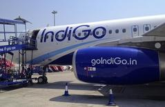 An IndiGo Airlines A320 aircraft is parked on the tarmac at Rajiv Gandhi International Airport in Hyderabad March 7, 2012. REUTERS/Vivek Prakash