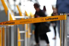 A barrier tape of German airline Lufthansa is seen at Munich airport October 20, 2014. REUTERS/Michaela Rehle