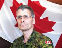 Warrant Officer Patrice Vincent, a member of the Joint Personnel Support Unit, Integrated Personnel Support Centre St-Jean, is pictured in this undated handout photo courtesy of the Canadian Forces. Vincent was killed when a Canadian man rammed two soldiers in Quebec with his car. REUTERS/Canadian Forces/Handout