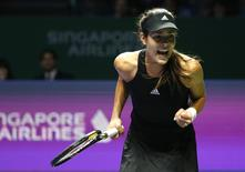 Ana Ivanovic of Serbia celebrates a point against Eugenie Bouchard of Canada during their WTA Finals singles tennis match at the Singapore Indoor Stadium October 22, 2014. REUTERS/Edgar Su